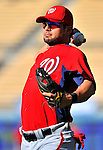 22 July 2011: Washington Nationals catcher Jesus Flores warms up prior to a game against the Los Angeles Dodgers at Dodger Stadium in Los Angeles, California. The Nationals defeated the Dodgers 7-2 in their first meeting of the 2011 season. Mandatory Credit: Ed Wolfstein Photo