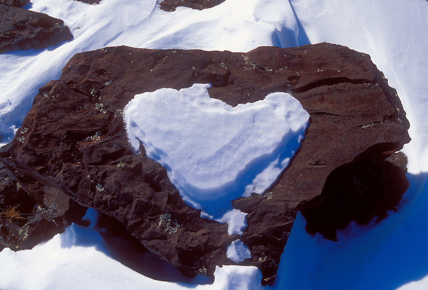 A rock holds a heart-shaped patch of snow on the Lake Superior shoreline near Two Harbors, Minn.