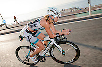 Triathlete Beth Walsh rides along the Promenade des Anglais during Ironman France 2012, Nice, France, 24 June 2012