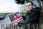 Paddy Kevane holding a photo of his sister Breda who is in Cork University Hospital awaiting a vital operation