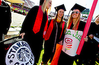 Stanford University students Teagan Gerhart, Sarah Hassman and Jenna Rich, participate in the traditional Wacky Walk at Stanford Stadium during 122nd Commencement program on Sunday, June 16, 2013.