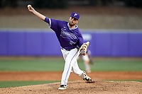 Pitcher Austin Wood (34) of the Furman Paladins delivers a pitch in game two of a doubleheader against the Harvard Crimson on Friday, March 16, 2018, at Latham Baseball Stadium on the Furman University campus in Greenville, South Carolina. Furman won, 7-6. (Tom Priddy/Four Seam Images)