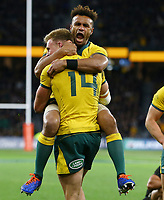 Reece Hodge (14) of the Wallabies celebrates a try with Will Genia during the Rugby Championship match between Australia and New Zealand at Optus Stadium in Perth, Australia on August 10, 2019 . Photo: Gary Day / Frozen In Motion
