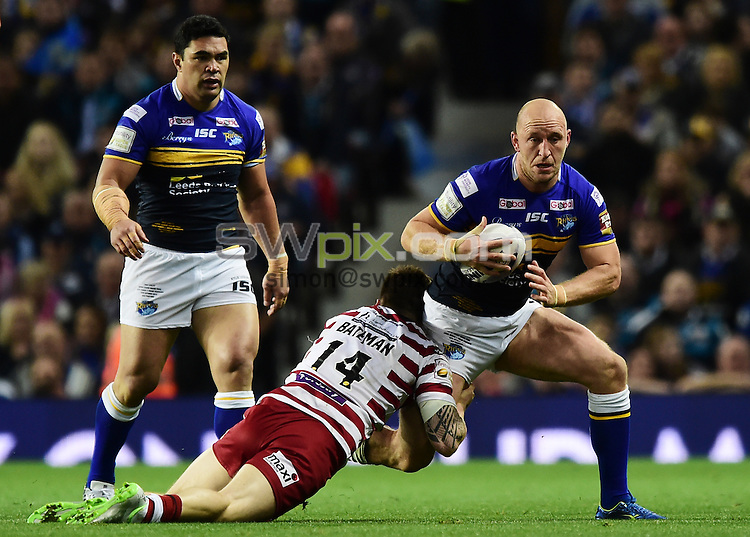 Picture by Alex Broadway/SWpix.com - 10/10/2015 - Rugby League - First Utility Super League Grand Final - Leeds Rhinos v Wigan Warriors - Old Trafford, Manchester, England - Carl Ablett of Leeds Rhinos is tackled by John Bateman of Wigan Warriors.