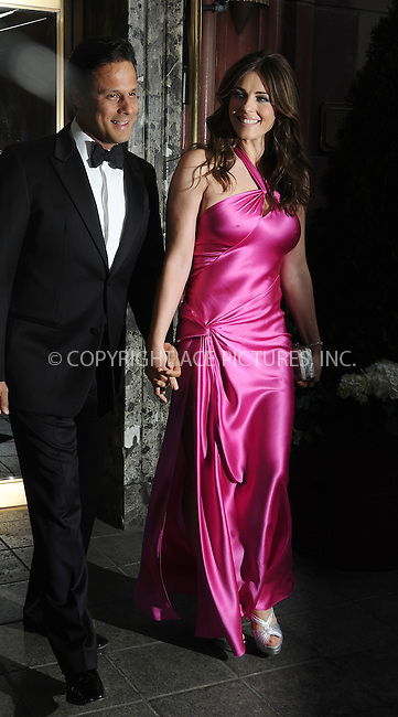 WWW.ACEPIXS.COM . . . . .  ....April 29 2009, New York City....(L-R) Arun Nayar and Elizabeth Hurley leave their hotel on the way to an event on April 29, 2009 in New York City.....Please byline: AJ Sokalner - ACEPIXS.COM..... *** ***..Ace Pictures, Inc:  ..tel: (212) 243 8787..e-mail: info@acepixs.com..web: http://www.acepixs.com