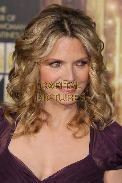 "Michelle Pfeiffer.The World Premiere of ""New Year's Eve' held at The Grauman's Chinese Theatre in Hollywood, California, USA..December 5th, 2011.headshot portrait purple .CAP/CEL .©CelPh/Capital Pictures."