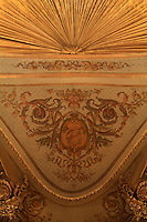 "Detail of vaulted ceiling and drapery, first balcony, Theatre Imperial Napoleon III de Fontainebleau (Fontainebleau Theatre Napoleon III), 1853-1856, by Hector Lefuel, Fontainebleau, Seine-et-Marne, France. Restoration of the theatre began in Spring 2013 thanks to an agreement between the Emirate of Abu Dhabi and the French Governement dedicating 5 M€ to the restoration.  In recognition of the sponsorship by the Emirate of Abu Dhabi, French Governement decided to rename the theatre as ""Theatre Cheikh Khalifa bin Zayed Al Nahyan"" (Cheikh Khalifa bin Zayed Al Nahyan Theatre). The achievement of the first stage of renovation has allowed the opening of the theatre to the public on May 3, 2014. Picture by Manuel Cohen"