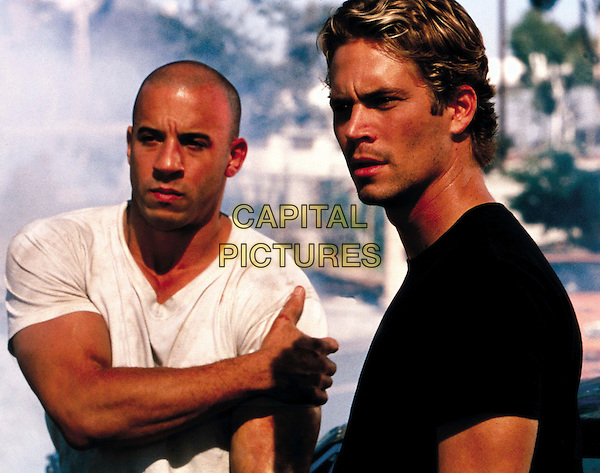 VIN DIESEL & PAUL WALKER.in The Fast and the Furious (2001) .*Filmstill - Editorial Use Only*.CAP/FB.Supplied by Capital Pictures.