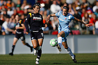 Keeley Dowling (17) of Sky Blue FC is defended by Han Duan (9) of the Los Angeles Sol. The Los Angeles Sol defeated Sky Blue FC 2-0 during a Women's Professional Soccer match at TD Bank Ballpark in Bridgewater, NJ, on April 5, 2009. Photo by Howard C. Smith/isiphotos.com