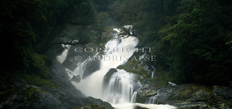 Waterfall on Lake Alice river. George Sound. Fiordland National Park New Zealand.