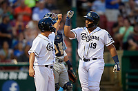 Kane County Cougars third baseman Eudy Ramos (19) is congratulated by right fielder Ernie De La Trinidad (17) after hitting a home run in the bottom of the fifth inning during a game against the West Michigan Whitecaps on July 19, 2018 at Northwestern Medicine Field in Geneva, Illinois.  Kane County defeated West Michigan 8-5.  (Mike Janes/Four Seam Images)