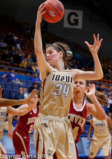 SIOUX FALLS, SD - MARCH 10:  Nevena Markovic #34 of IUPUI grabs a pass as she heads to the basket against Denver during their semifinal game at the 2014 Summit League Basketball Championships Monday at the Sioux Falls Arena. (Photo by Dick Carlson/Inertia)