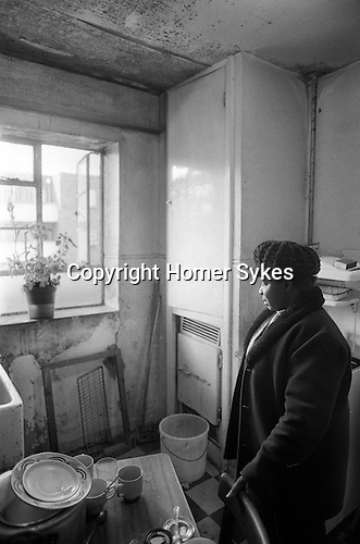 Woman alone in damp kitchen of her Hoxton high rise flat London 1978.<br /> <br /> <br /> My ref 31/3519/, 1978,