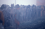 Sky clad Naga Sadhus on their way to bathe at the Sangam where the Ganges, Yamuna and Saraswati Rivers meet. It was estimated that over 100,000 Sadhus and holy men attended the Maha Kumbha Mela in 1989. Maha Kumbha Mela is held every twelve years at Prayag (Allahabad) in Uttar Pradesh in India.