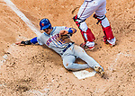 30 April 2017: New York Mets shortstop Matt Reynolds slides home in the 4th inning to score the Mets' 4th run against the Washington Nationals at Nationals Park in Washington, DC. The Nationals defeated the Mets 23-5 in the third game of their weekend series. Mandatory Credit: Ed Wolfstein Photo *** RAW (NEF) Image File Available ***