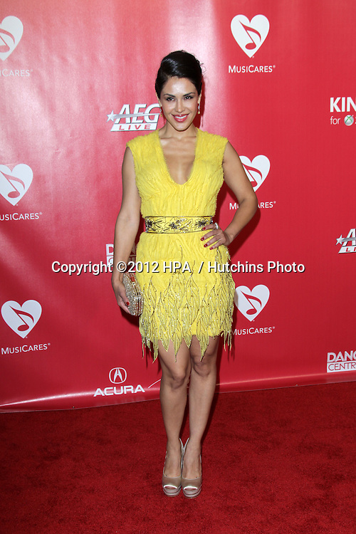 vLOS ANGELES - FEB 10:  Carla Ortiz arrives at the 2012 MusiCares Gala honoring Paul McCartney at LA Convention Center on February 10, 2012 in Los Angeles, CA