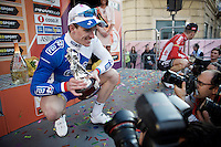 race winner Arnaud Démare (FRA/FDJ) showing off his trophy to the press after winning the 107th Milano-Sanremo (2016)