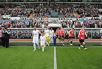 Pictured: The teams led by captains Ashley Williams for Swansea (L) and Wayne Rooney for Manchester United take to the pitch Sunday 30 August 2015<br /> Re: Premier League, Swansea v Manchester United at the Liberty Stadium, Swansea, UK