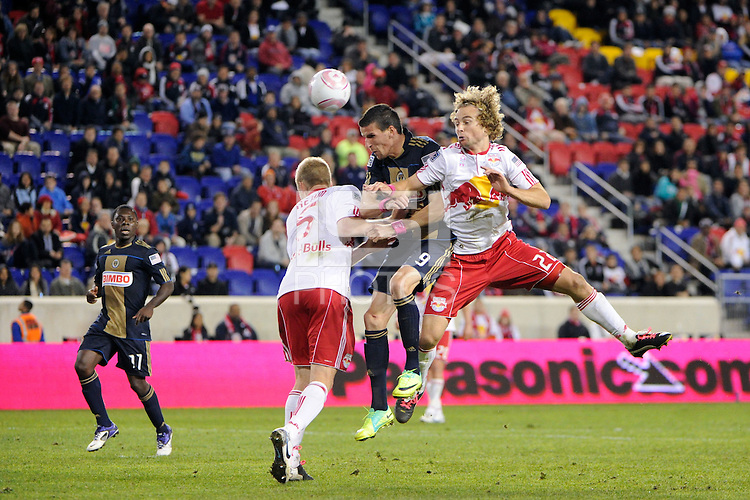 Sebastien Le Toux (9) of the Philadelphia Union battles for a header with Tim Ream (5) and Stephen Keel (22) of the New York Red Bulls. The New York Red Bulls defeated the Philadelphia Union  1-0 during a Major League Soccer (MLS) match at Red Bull Arena in Harrison, NJ, on October 20, 2011.