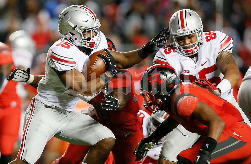 Ohio State Buckeyes running back Ezekiel Elliott (15) runs the ball as Ohio State Buckeyes tight end Marcus Baugh (85) makes a block during the college football game between the Rutgers Scarlet Knights and the Ohio State Buckeyes at High Point Solutions Stadium in Piscataway, NJ, Saturday night, October 24, 2015. The Ohio State Buckeyes defeated the Rutgers Scarlet Knights 49 - 7. (The Columbus Dispatch / Eamon Queeney)