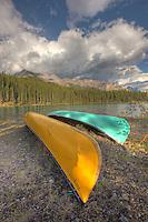 Canoes sit on the shore of Maligne Lake, Jasper National Park.