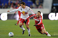 Marco Pappa (16) of the Chicago Fire goes down asSinisa Ubiparipovic (8) of the New York Red Bulls plays the ball during the first half of a Major League Soccer match between the New York Red Bulls and the Chicago Fire at Red Bull Arena in Harrison, NJ, on March 27, 2010.