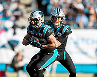 CHARLOTTE, NC - NOVEMBER 3: Christian McCaffrey #22 of the Carolina Panthers takes a handoff from quarterback Kyle Allen #7 during a game between Tennessee Titans and Carolina Panthers at Bank of America Stadium on November 3, 2019 in Charlotte, North Carolina.