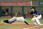 Omaha Storm Chasers' Pedro Ciriaco dives back under the tag of Reno Aces' Danny Dorn during a game in Reno, Nev., on Sunday, Aug. 24, 2014.<br /> Photo by Cathleen Allison