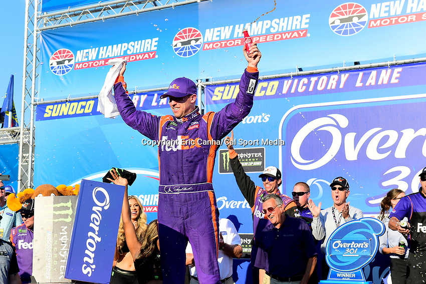 July 16, 2017 - Loudon, New Hampshire, U.S. - Denny Hamlin, Monster Energy NASCAR Cup Series driver of the FedEx Office Toyota (11), celebrates winning the NASCAR Monster Energy Overton's 301 race held at the New Hampshire Motor Speedway in Loudon, New Hampshire. Larson placed first in the qualifier. Eric Canha/CSM