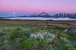 Grand Teton National Park, WY: Split rail fence with moonset over the Teton Range and Snake River Valley