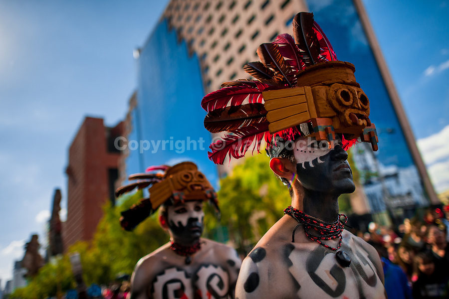 Mexican men, wearing colorful feather masks inspired by Aztecs, take part in the Day of the Dead festival in Mexico City, Mexico, 29 October 2016. Day of the Dead (Día de Muertos), a syncretic religious holiday combining the death veneration rituals of the ancient Aztec culture with the Catholic practice, is celebrated throughout all Mexico. Based on the belief that the souls of the departed may come back to this world on that day, people gather at the gravesites in cemeteries praying, drinking and playing music, to joyfully remember friends or family members who have died and to support their souls on the spiritual journey.