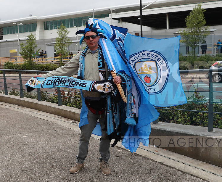 Flag and scarf seller with Champions 2017/18 merchandise during the premier league match at the Etihad Stadium, Manchester. Picture date 22nd April 2018. Picture credit should read: Simon Bellis/Sportimage