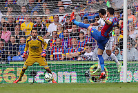 Pictured: Lukasz Fabianski of Swansea (L) prepares to catch a shot by Joel Ward of Crystal Palace (R)<br />