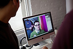 BROOKLYN -- APRIL 16, 2011: Josh Stewart sets up a webcam on his iMac to be used as a mirror for people trying on clothes at their garage sale at Studiomates on April 16, 2011 in Dumbo, Brooklyn.   (PHOTOGRAPH BY MICHAEL NAGLE)