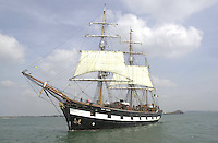 Jeanie johnston sails from Fenit to Cork 9-4-02.With her flag at half mast for the Queen Mother's funeral, The Jeanie Johnston replica famine ship sails out of Fenit Harbour bound for Cork on her maiden voyage  on Tuesday..Picture by Don MacMonagle
