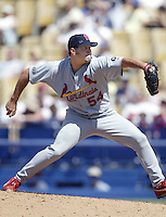 Mike Crudale of the St. Louis Cardinals pitches during a 2002 MLB season game against the Los Angeles Dodgers at Dodger Stadium, in Los Angeles, California. (Larry Goren/Four Seam Images)