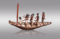 Ancient Egyptian model of a boat with mast, Middle Kingdom (1980-1700 BC. Egyptian Museum, Turin. Grey Background.<br /> <br /> Wooden tomb models were an Egyptian funerary custom throughout the Middle Kingdom in which wooden figurines and sets were constructed to be placed in the tombs of Egyptian royalty.