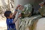 A girl gets water to drink in Pakistan.