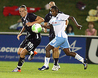 Abby Wambach #20 of the Washington Freedom moves the ball away from Formiga #8 of the Chicago Red Stars during a WPS match at the Maryland Soccerplex, in Boyds Maryland on June 12 2010. The game ended in a 2-2 tie.