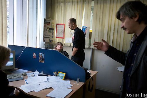 An editor (right) and journalists discuss issues at the editorial office of the Novaya Gazeta newspaper in Moscow. .Novaya Gazeta, known for its critical stance, counted among its journalists Anna Politkovskaya, shot dead in her apartment block in October 2006..Politkovskaya was one of the strongest voices against the Kremlin and its policy in Chechnya. Two other journalist at Novaya Gazeta were murdered before her.