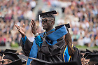 May 17, 2015; A graduate celebrates during the 2015 Commencement Ceremony in Notre Dame Stadium. (Photo by Barbara Johnston/University of Notre Dame)