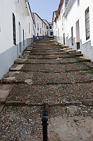 View up a cobbled street in the village of Aracena in Andalucia southern Spain