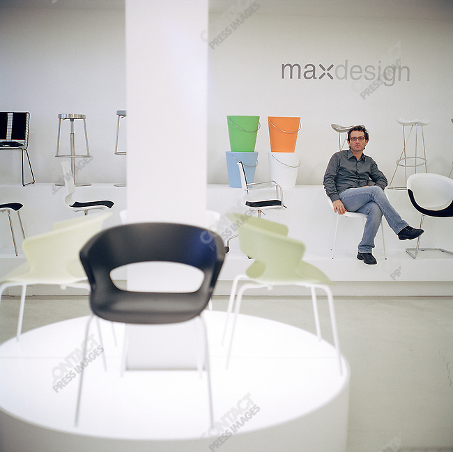 """Massimo Martino, managing director of maxdesign, a chair company based in the so called """"Chair Triangle"""" near Udine in north-east Italy, in his main showroom. October 8, 2007"""