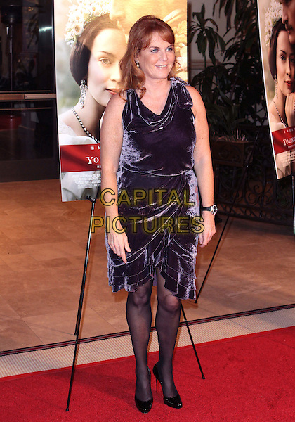 "SARAH FERGUSON, Duchess Of York.""The Young Victoria"" US Premiere held The Pacific Theatres The Grove, Los Angeles, California, USA, .3rd December 2009..full length dress  purple velvet fergie royal wrap sleeveless tiered black shoes tights .CAP/ADM/TC.©T. Conrad/AdMedia/Capital Pictures."