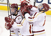 Edwin Shea (BC - 8), Pat Mullane (BC - 11), Johnny Gaudreau (BC - 13) and Tommy Cross (BC - 4) celebrate Mullane's goal which gave BC a 1-0 lead late in the second period. - The Boston College Eagles defeated the visiting University of Massachusetts-Amherst Minutemen 2-1 in the opening game of their 2012 Hockey East quarterfinal matchup on Friday, March 9, 2012, at Kelley Rink at Conte Forum in Chestnut Hill, Massachusetts.