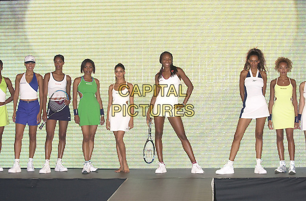 VENUS WILLIAMS.Catwalk Show, London..full length tennis raquet.Ref: PL.www.capitalpictures.com.sales@capitalpictures.com.©Capital Pictures.