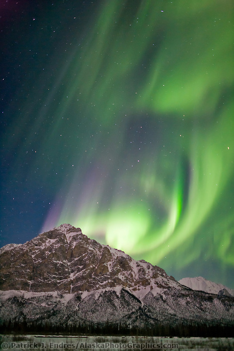 Aurora borealis over Mount Dillon, Brooks range, Arctic, Alaska.
