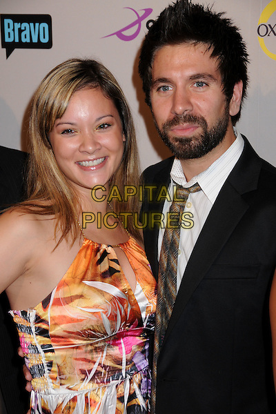 JOSHUA GOMEZ & GUEST.NBC Universal 2008 Press Tour All-Star Party at the Beverly Hilton Hotel, Beverly Hills, California, USA..July 20th, 2008.half length beard black suit jacket dress orange pattern facial hair  .CAP/ADM/BP.©Byron Purvis/AdMedia/Capital Pictures.