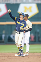 Michigan Wolverines third baseman Blake Nelson (10) celebrates hitting a double against the Vanderbilt Commodores during Game 3 of the NCAA College World Series Finals on June 26, 2019 at TD Ameritrade Park in Omaha, Nebraska. Vanderbilt defeated Michigan 8-2 to win the National Championship. (Andrew Woolley/Four Seam Images)