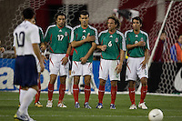 USA's Landon Donovan, foreground, assesses the Mexican team wall. USA 2, Mexico 0, at the University of Phoenix Stadium in Glendale, AZ on February 7, 2007.